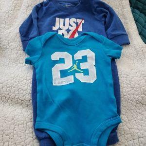 2 baby Nike and Jordan 23 bodysuits